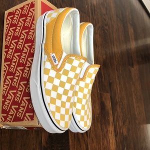 YELLOW CHECKERBOARD SLIP-ON VANS